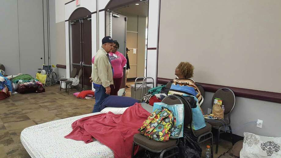 Humble Mayor Merle Aaron talks to evacuees at the Humble Civic Center on Tuesday, Aug. 29. Photo: Melanie Feuk