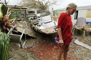 Port Aransas resident Melanie Zurwaski stands in her backyard where a boat and other debris came to rest in the aftermath of Hurricane Harvey in Port Aransas, Texas on Sunday, Aug. 27, 2017. Zurwaski's home was destroyed but she managed to get through the category four storm. (Kin Man Hui/San Antonio Express-News)
