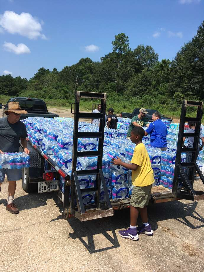 Volunteers at the Silsbee YYAFA loading water for storage at Kirby Gym, for later delivery to water-deprived areas. Sept. 1, 2017 Photo: Tim Collins