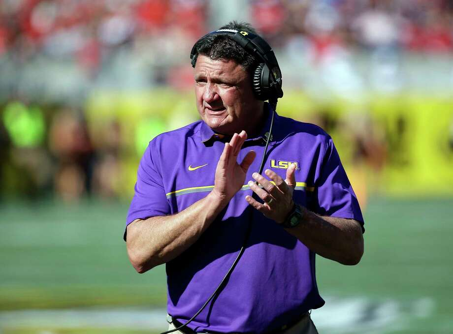 FILE - In this Dec. 31, 2016, file photo, LSU coach Ed Orgeron encourages players during the second half of the Citrus Bowl NCAA football game against Louisville in Orlando, Fla. Orgeron will be one of the coaches to take the podium Monday, July 10, 2017, at the SEC media days in suburban Birmingham, Ala. (AP Photo/John Raoux, File) Photo: John Raoux, STF / Internal