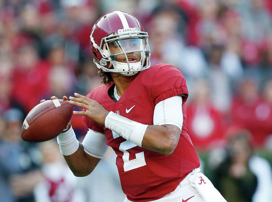 FILE - In this Nov. 26, 2016 file photo, Alabama quarterback Jalen Hurts sets back to pass during the first half of the Iron Bowl NCAA college football game against Auburn,  in Tuscaloosa, Ala. Former Oklahoma University quarter back Jamelle Holieway dazzled the college football world as a true freshman who mastered Oklahoma's dynamic wishbone attack and led the Sooners to the 1985 national championship. Now, Alabama true freshman Hurts is on the cusp of becoming the first true freshman quarterback since Holieway to win it all.  (AP Photo/Brynn Anderson, File) Photo: Brynn Anderson, STF / Copyright 2016 The Associated Press. All rights reserved.