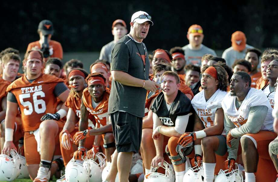 Coach Tom Herman gets the attention of players early with a talk after warm up as the Longhorns begin their fall football practice at Frank Denius Fields at the University of Texas on July 31, 2017. Photo: Tom Reel, Staff / 2017 SAN ANTONIO EXPRESS-NEWS