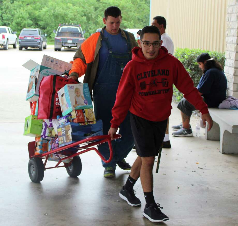 Volunteers bring in supplies to Cornerstone Church on Aug. 30. Cornerstone Church housed an estimated 250 victims of Hurricane Harvey. Photo: Jacob McAdams