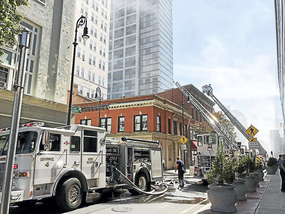 New Haven firefighters battle 2 alarm fire downtown