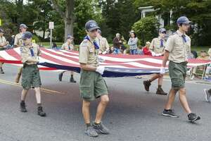 Newtown Boy Scouts carry the flag in the Newtown Labor Day Parade on Main Street. Monday, Sept. 5, 2016