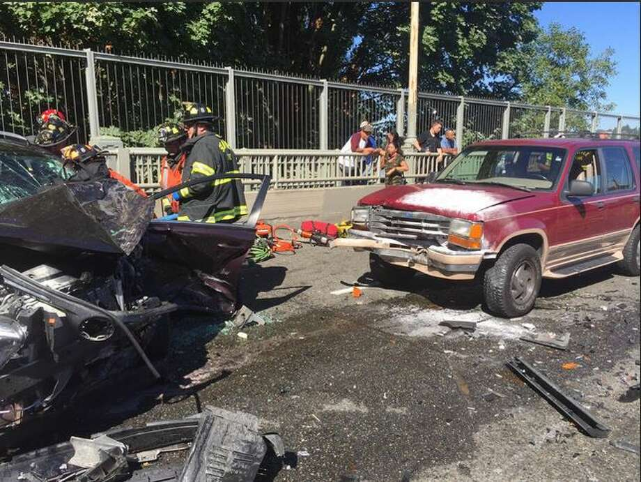 Two patients were hospitalized after a three-car crash on the Aurora Bridge Friday morning. The crash shut down most lanes on the highway. Photo: Seattle Fire Department