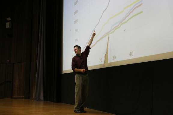 Professor David Wagner goes over a chart that is analyzing data during the first day of the Foundations of Data Science course at UC Berkeley campus August 23, 2017 in Berkeley, Calif.
