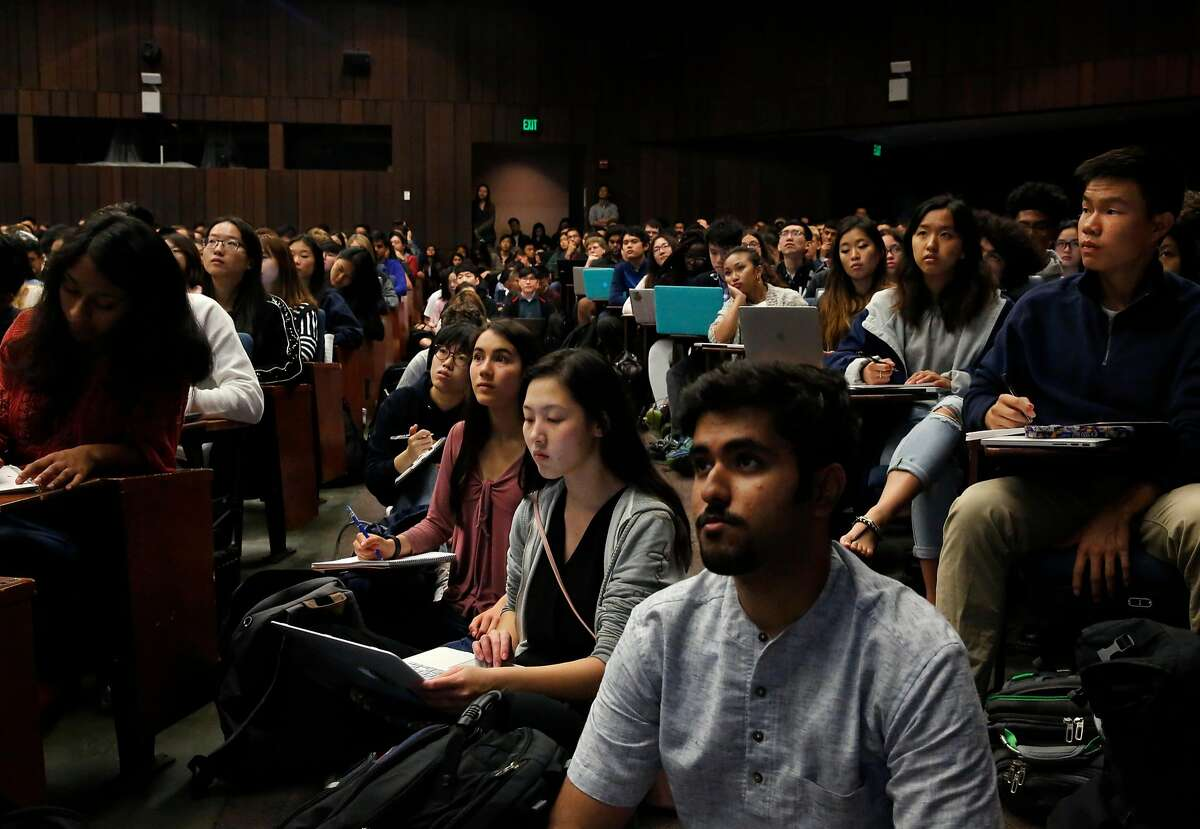 Students overflow into the aisles, from front right to back left, freshman Pranav Bhasin, electrical engineering, computer science major, freshman Shirley Li, bio engineering major, freshman Sasha Manghise, bio engineering major, and freshman Jinxin Xiong, mathematics major during the first day of the Foundations of Data Science course at UC Berkeley campus August 23, 2017 in Berkeley, Calif.