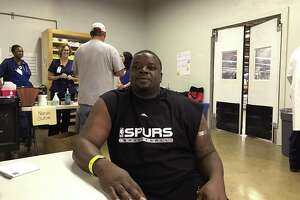 Anthony Odom, a 38-year-old Corpus Christi resident who evacuated Aug. 24 to San Antonio, visits the medical clinic at the shelter after developing a cough while staying at the shelter.