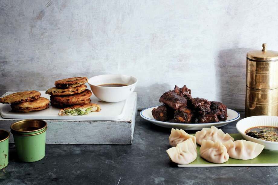 "Alex Guarnaschelli's new book, ""The Home Cook,"" includes recipes for Scallion Pancakes, Glazed Five-Spice Ribs and Spicy Chinatown Pork Dumplings. Photo: Johnny Miller / Contributed Photo / Connecticut Post Contributed"