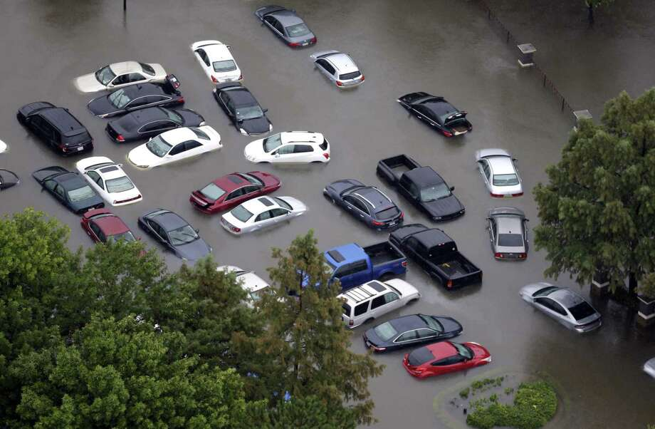 Flooded cars near the Addicks Reservoir are shown as floodwaters from Tropical Storm Harvey rise this week in Houston. Owners likely will shop for new vehicles but up to 500,000 new cars at Houston dealerships also were flooded, according to one estimate. Photo: David J. Phillip /Associated Press / Copyright 2017 The Associated Press. All rights reserved.