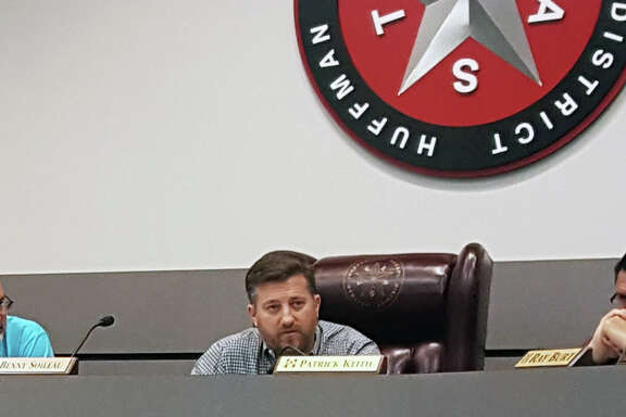 Huffman ISD Superintendent Benny Soileau explains the need to fund emergency repairs on district facilities that sustained damage from flooding during an emergency school board meeting on Friday, Sept. 1.