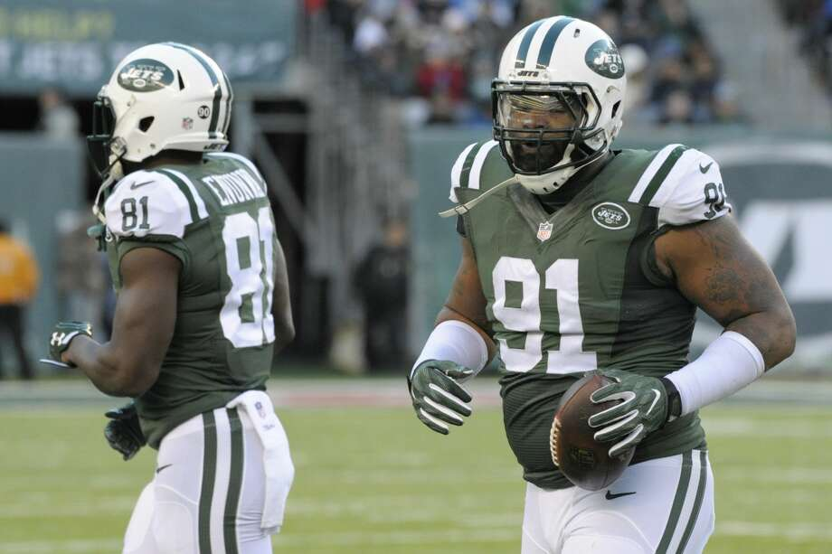 New York Jets defensive end Sheldon Richardson (91) leaves the field with the ball after recovering a Buffalo Bills fumble during the second half of an NFL football game, Sunday, Jan. 1, 2017, in East Rutherford, N.J. (AP Photo/Bill Kostroun) Photo: Bill Kostroun/AP