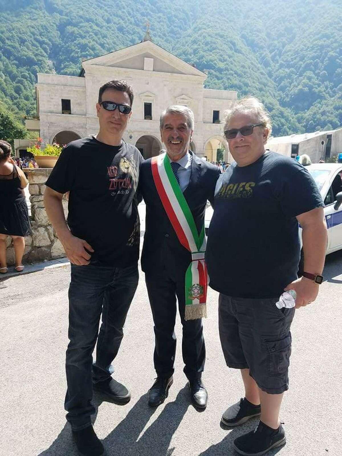 Band members Mario Socci, left, and Allan Tepper, right, pose with the mayor of Settefrati, Riccardo Frattaroli, center.