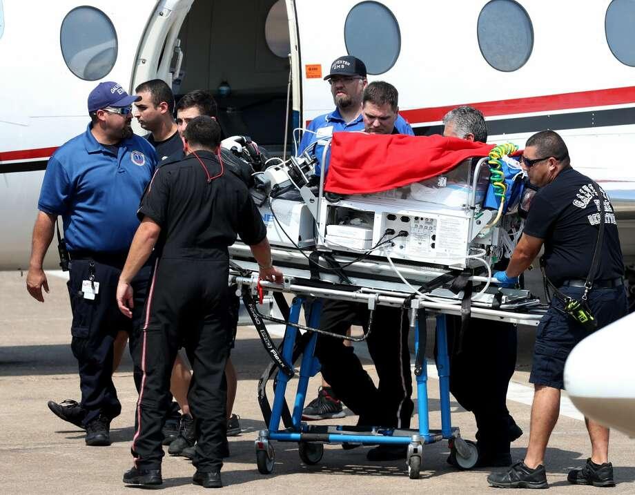 Babies from the Neonatal ICU unit at Beaumont's Baptist Hospital arrive at UTMB in Galveston. Photo: Jennifer Reynolds/Galveston Daily News