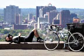 Michael Ciarleglio of Hamden takes a break after biking to the summit of East Rock Park in New Haven on 9/1/2017.  Ciarleglio had his personal best time on the segment from the gate to the summit which is recorded on the social media app, Strava, used for cycling, running and swimming.  Arnold Gold / Hearst Connecticut Media