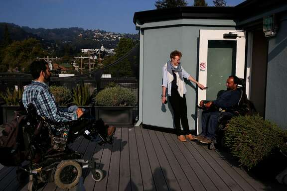 Alex Ghenis, left, shows Accomable co-founder and CEO Srin Madipalli, right, the roof as data scientist Vicky Clayton holds the door during a tour for the Chronicle August 23, 2017 in Berkeley, Calif. Ghenis is putting his apartment up on Accomable.