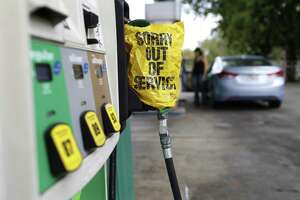 """A """"Sorry out of Service"""" sign is placed on one of the gas pumps at a gas station in Athens, Ga., on Friday, Sept. 1, 2017. Gasoline prices in the U.S. have risen to new high amid continuing fears of shortages in Texas and other states after Hurricane Harvey's strike. (Joshua L. Jones/Athens Banner-Herald via AP)"""