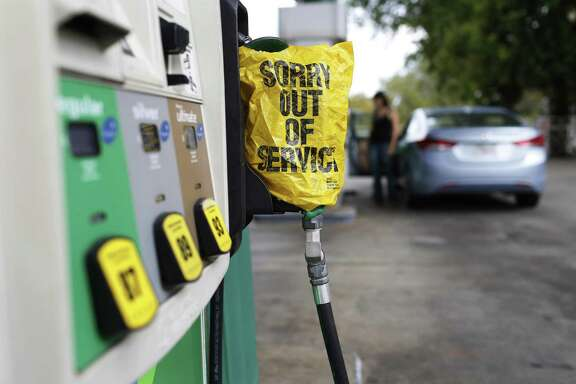 "A ""Sorry out of Service"" sign is placed on one of the gas pumps at a gas station in Athens, Ga., on Friday, Sept. 1, 2017. Gasoline prices in the U.S. have risen to new high amid continuing fears of shortages in Texas and other states after Hurricane Harvey's strike. (Joshua L. Jones/Athens Banner-Herald via AP)"