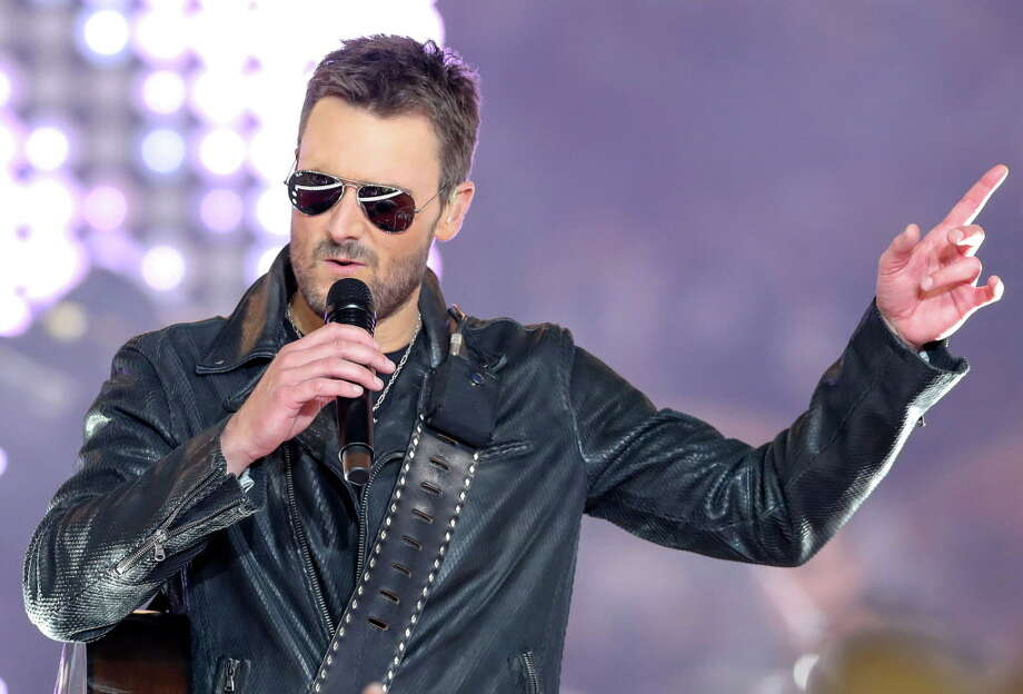 Country singer Eric Church performs at halftime of the Washington Redskins, Dallas Cowboys football game on Thursday, Nov. 24, 2016 at AT&T Stadium in Arlington, Texas. (Steve Nurenberg/Fort Worth Star-Telegram/TNS) Church has postponed his Sept. 8 concert at the Pavilion. Photo: Steve Nurenberg, MBR / Fort Worth Star-Telegram