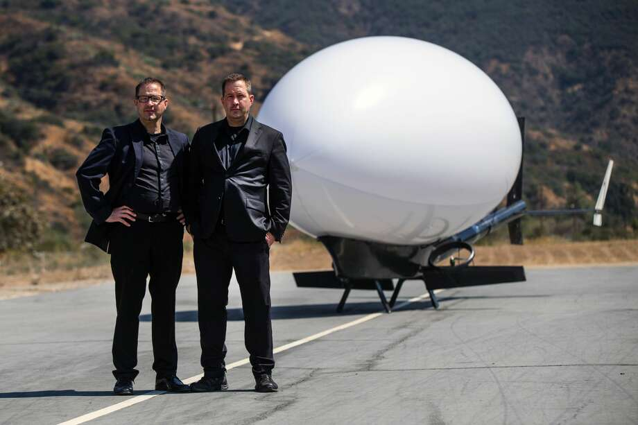 Brothers Joel (left) and James Egan stand with their creation, the PLIMP. Photo: Al Arena