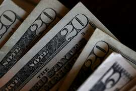SAN ANSELMO, CA - AUGUST 29:  In this Photo Illustration, Twenty and five dollar bills are displayed on August 29, 2017 in San Anselmo, California. The dollar fell to a two and a half year low to 91.77 Tuesday following the latest missile launch by North Korea. The U.S. dollar index has slipped over 10% since the inauguration of U.S. President Donald Trump.  (Photo Illustration by Justin Sullivan/Getty Images)