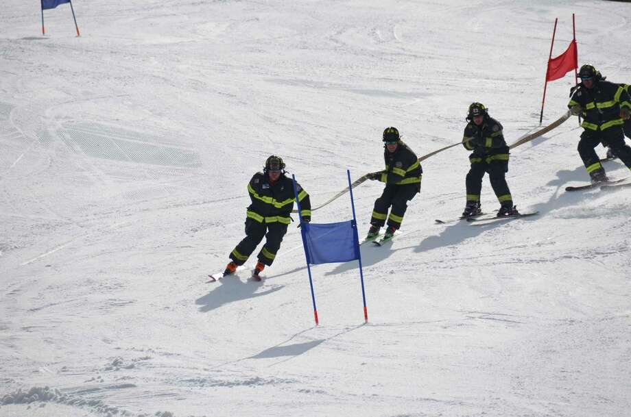 Danbury firefighters participate in a charity ski race. Photo: / Contributed