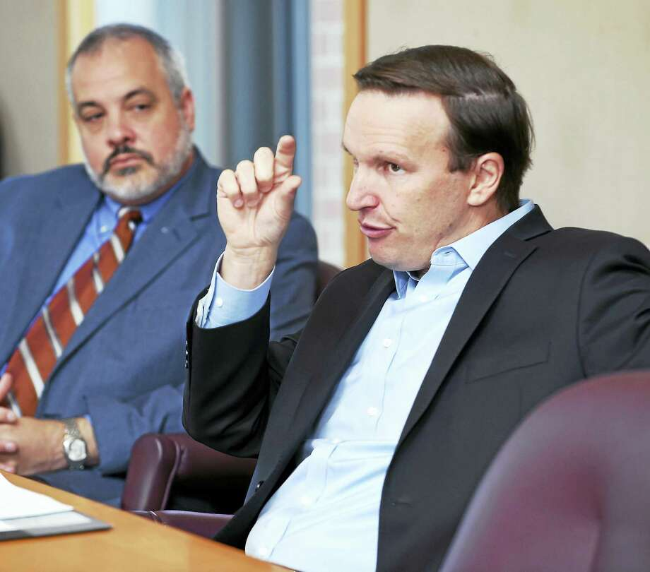 Southern Connecticut State University President Joe Bertolino (left) listens to U.S. Senator Chris Murphy (right) speak with students about college costs at SCSU's Engleman Hall in New Haven on 9/1/2017. Photo: Arnold Gold / Hearst Connecticut Media / New Haven Register