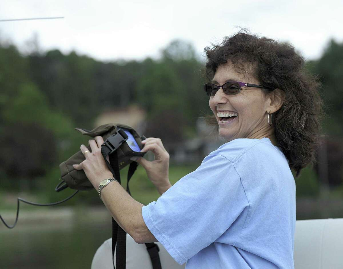 Theodora Pinou, a biology professor at Western Connecticut State University, reacts to finding fish Tuesday, August 2, 2016. A team of researchers use an antena to detect the frequency assosciated with various sterile grass carp released in June. This will help them track the movement of the fish throughout Candlewood Lake.