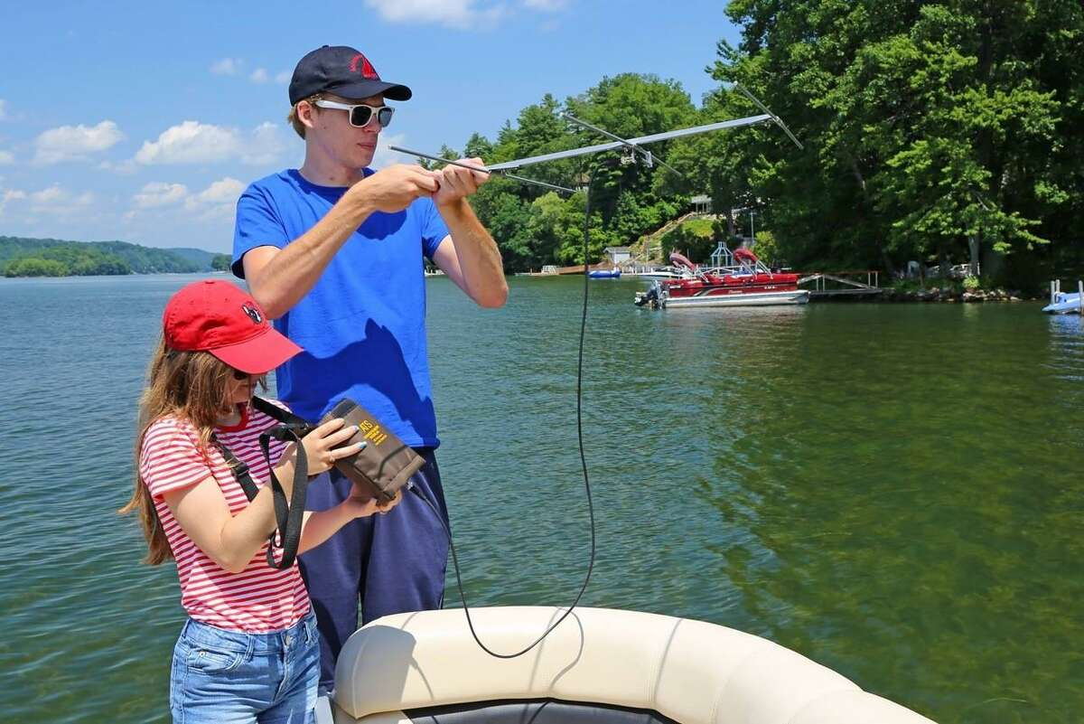 Interns Emily Van Vlack and Luke Mueller collect data for the carp tracking program on Candlewood Lake.
