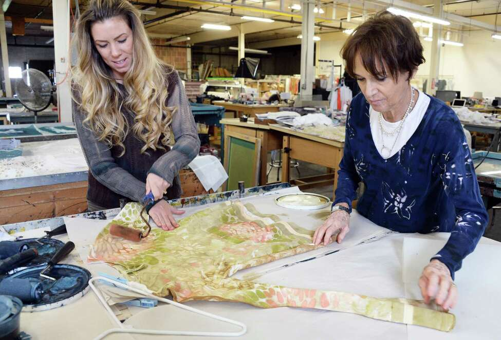 Audrey Sadler, left, and design director Marika Contompasis prepare new spring 2018 designs at the Marika Charles Factory textile art and design studio Friday Sept.1, 2017 in Schenectady, NY. (John Carl D'Annibale / Times Union)
