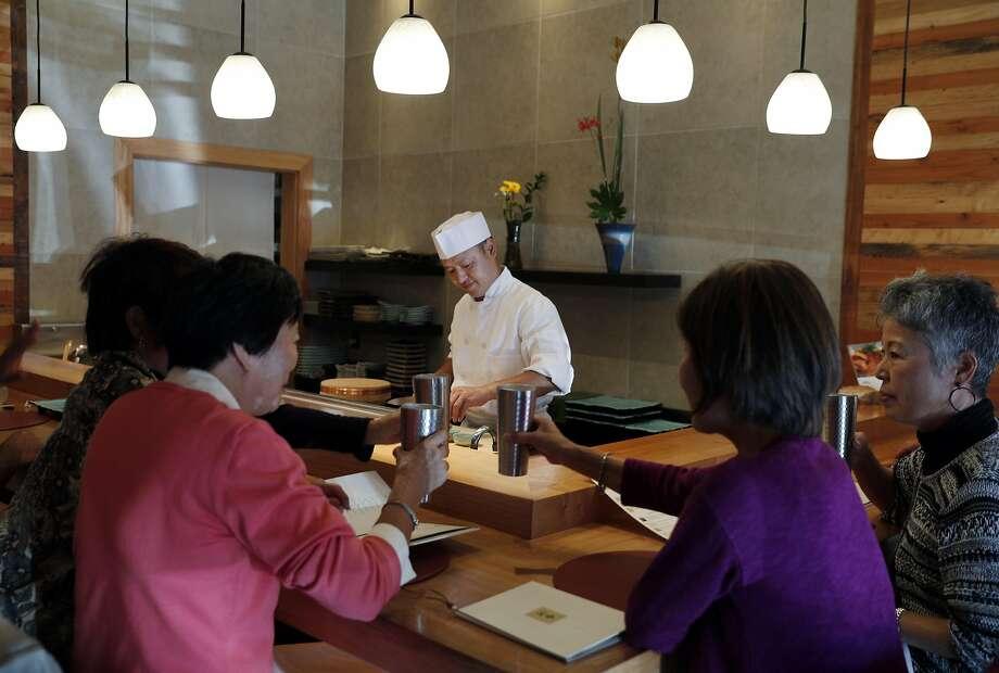 At Wako in S.F.: Chef Tomoharu Nakamura at the counter. Photo: Carlos Avila Gonzalez, The Chronicle