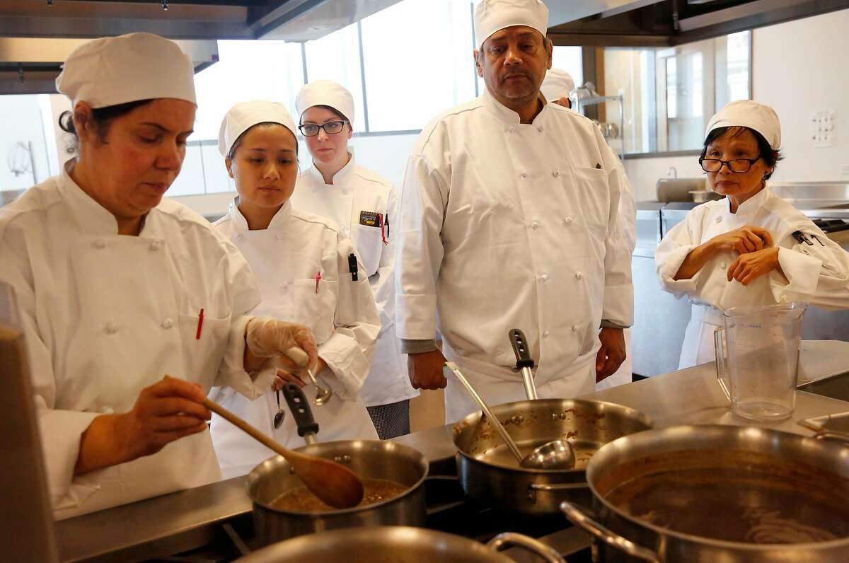 Students, from left, Marcie Forouhi, Karen Yu, K. Marsh, Abimahael Mercado and Wing Yee wait their turn to sample a soup during culinary arts basic training class at the Chinatown/North Beach Center of the City College of San Francisco August 31, 2017 in San Francisco, Calif.