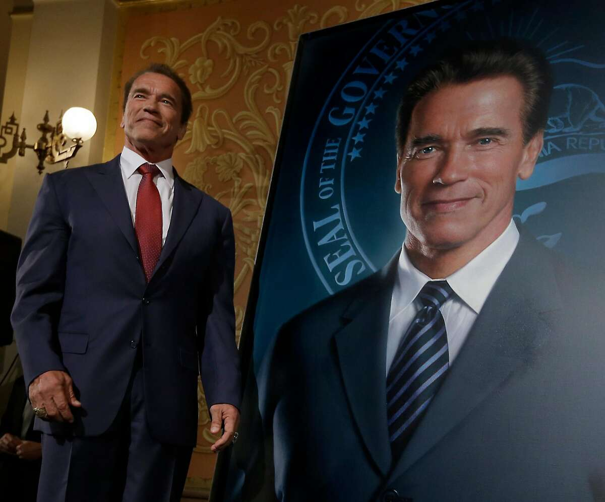 Former Gov. Arnold Schwarzenegger poses with his official portrait in Sacramento. Schwarzenegger has made a return to the political stage with a crusade for redistricting reform.