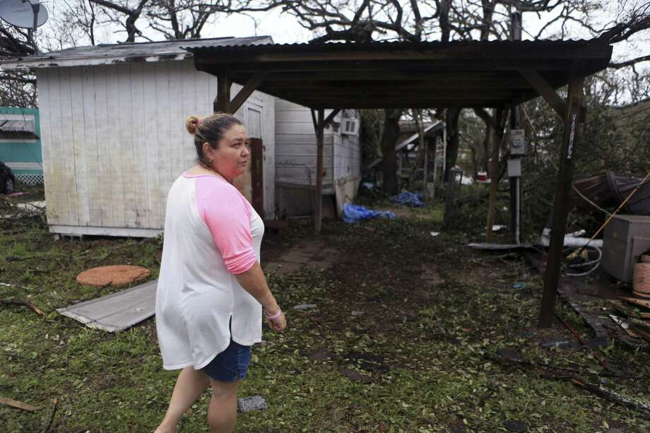 Darlene Vasquez returned to what was going to be a retirement home to survey the damage in the wake of Hurricane Harvey last week in Fulton, Texas. Research shows that damage from natural disasters hit low-income people and residents of color most heavily. Photo: Rachel Denny Clow /Associated Press / Corpus Christi Caller-Times