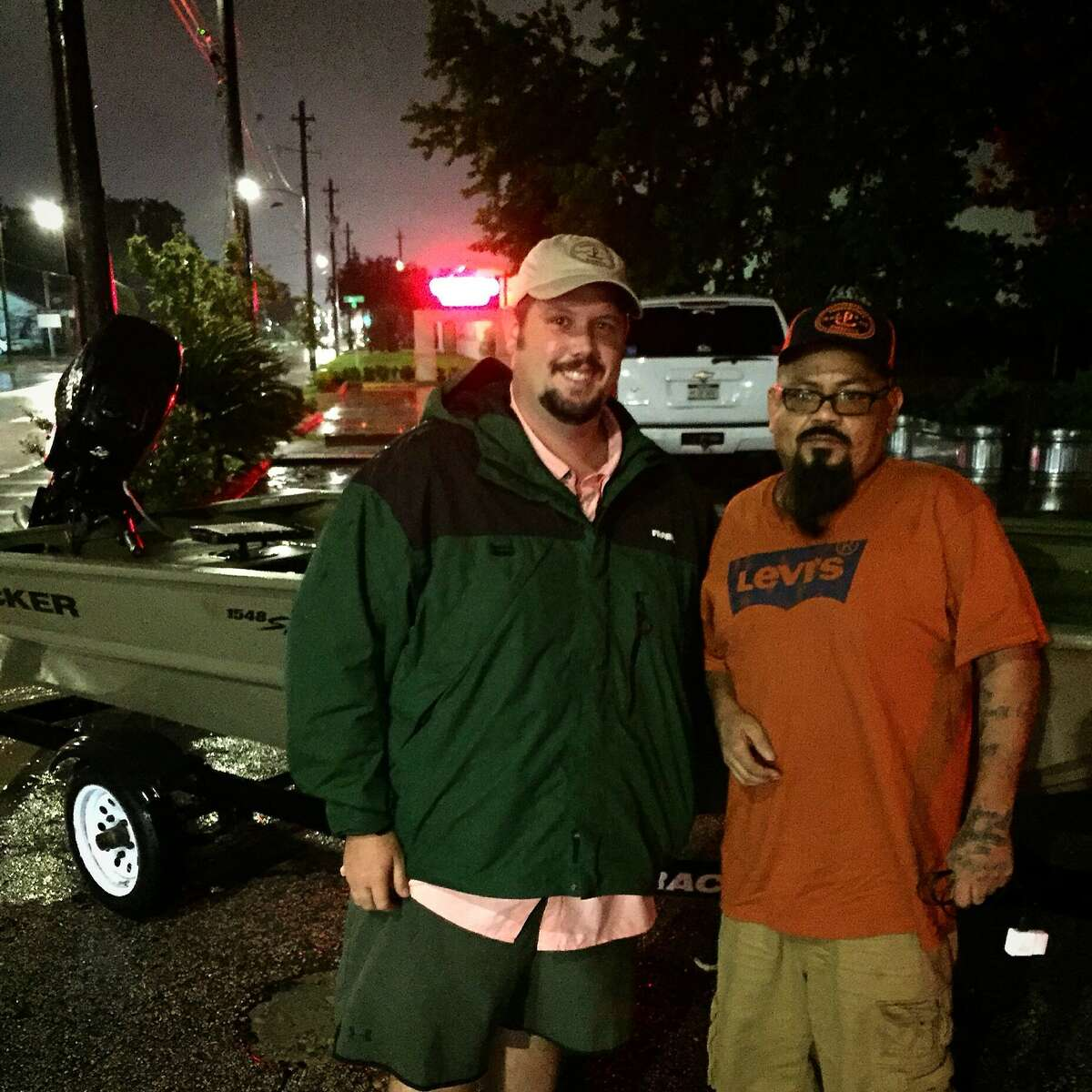 Pinkerton Barbecue's Grant Pinkerton, left, with employee Jose Pacheco, after Pacheco was rescued from rising flood waters during Hurricane Harvey. Pinkerton used social media to help facilitate the rescue.