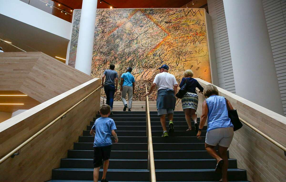 "Works by Julie Mehretu, titled ""Howl, eon ( I, II )"" 2017, hang in the lobby of the San Francisco Museum of Modern Art in San Francisco, Ca. on Fri. September 1, 2017. ""Howl, eon ( II ), is pictured."