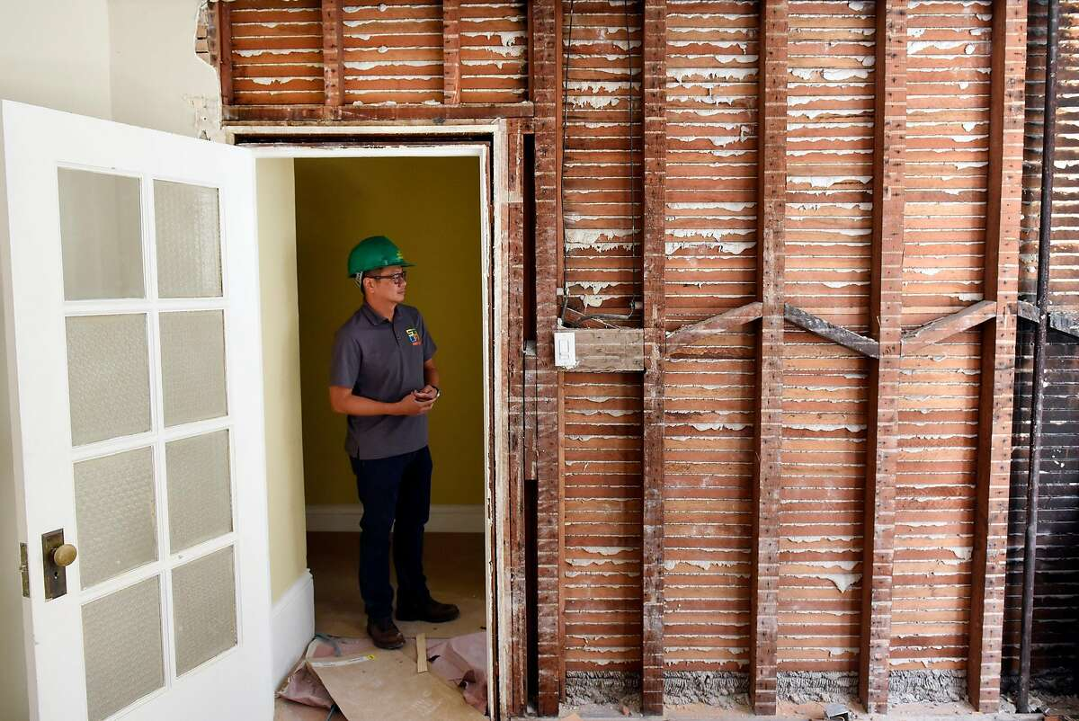 Henry Mak, director and senior project manager for SGDM contractors, stands in a doorway in a mixed residential and commercial building his company is retrofitting in San Francisco, Calif., on Thursday August 31, 2017. Property owners in San Francisco are scrambling to retrofit their buildings as a new deadline looms for bringing buildings into compliance with the earthquake safety focused