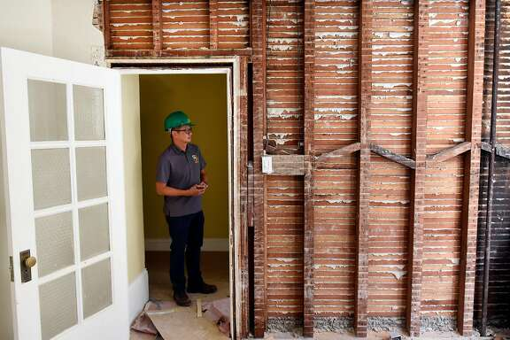 """Henry Mak, director and senior project manager for SGDM contractors, stands in a doorway in a mixed residential and commercial building his company is retrofitting in San Francisco, Calif., on Thursday August 31, 2017. Property owners in San Francisco are scrambling to retrofit their buildings as a new deadline looms for bringing buildings into compliance with the earthquake safety focused """"soft story"""" ordinance."""