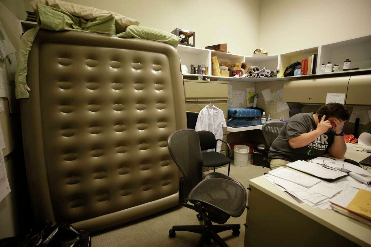 Jim Rightmire, associate chief of building operations, works in his office at the MFAH, 1001 Bissonnet, along with his inflatable bed Wednesday, Aug. 30, 2017, in Houston. Personnel have had the epic task of protecting and mitigating damage at the MFAH campus and its two house museums during the Hurricane Harvey. ( Melissa Phillip / Houston Chronicle )