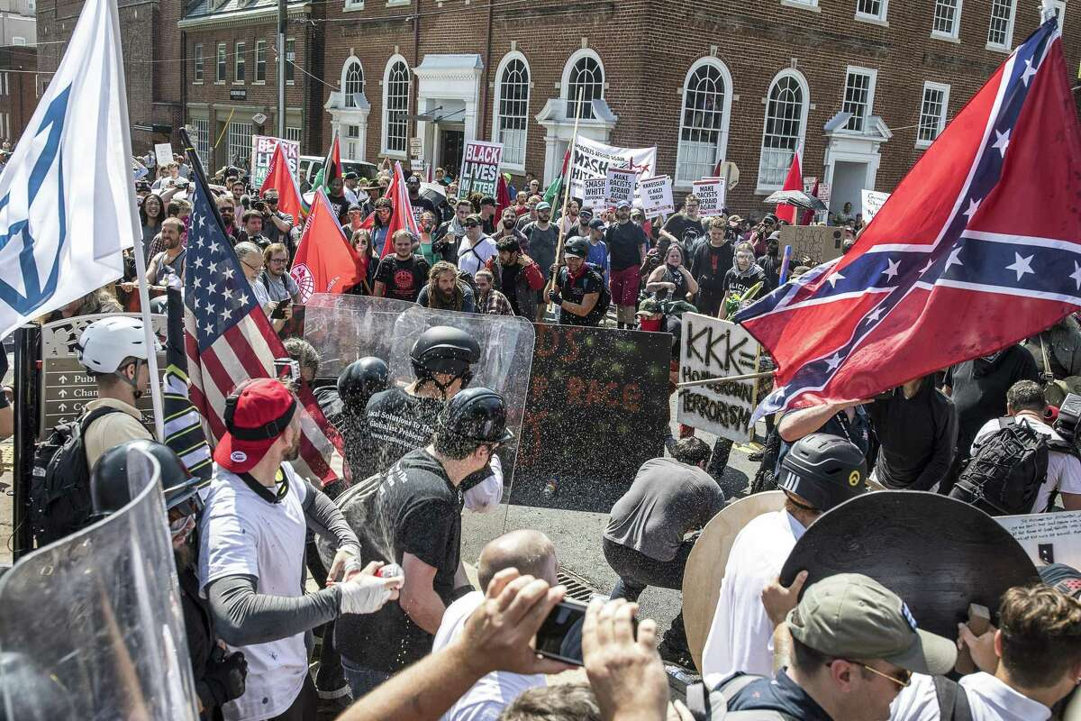 White nationalists riot with counter protesters in Charlottesville, Virginia, Aug. 12. Extremist behavior in protests and on social media can lead to employment punishment.
