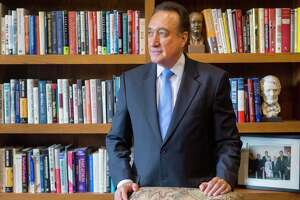 Henry Cisneros explains his roles at two companies while at his downtown San Antonio office.