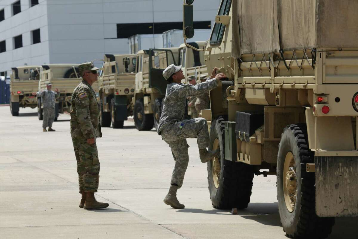 Members of the 49th Transportation Battalion and the 1st Medical Brigade from Fort Hood Texas prepare to leave their base camp in Houston for a mission near Wharton, Texas, on Friday, Sept. 1, 2017.