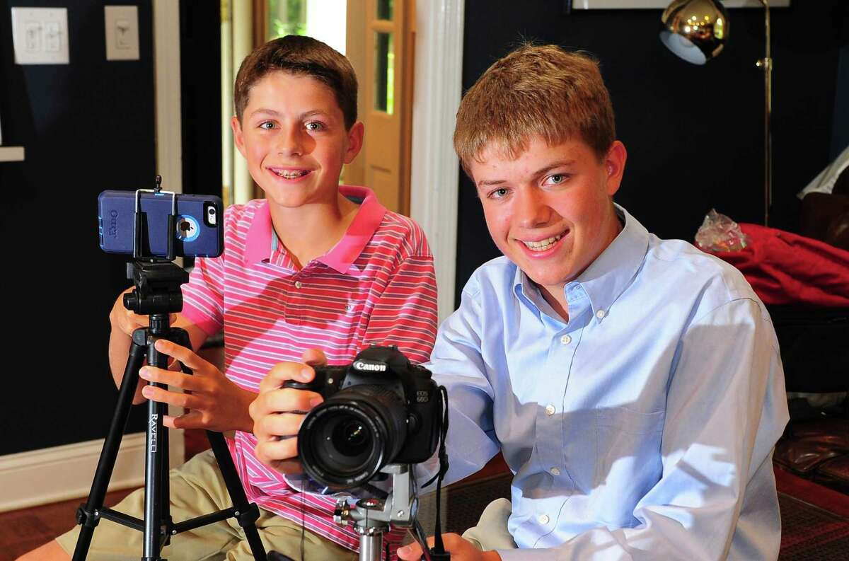 Ryan Anastasio, right, poses with his brother Sam, who assists him on shoots, while at his home in Woodbridge, Conn. on Thursday Aug. 31, 2017. This budding student journalist has interviewed practically every major political figure in the state, from Chris Murphy to Joe Scarborough, for his Raving Ryan website and YouTube channel.