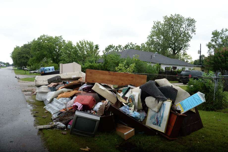 In South Houston, damaged furniture and household appliances lined the side of streets after Harvey