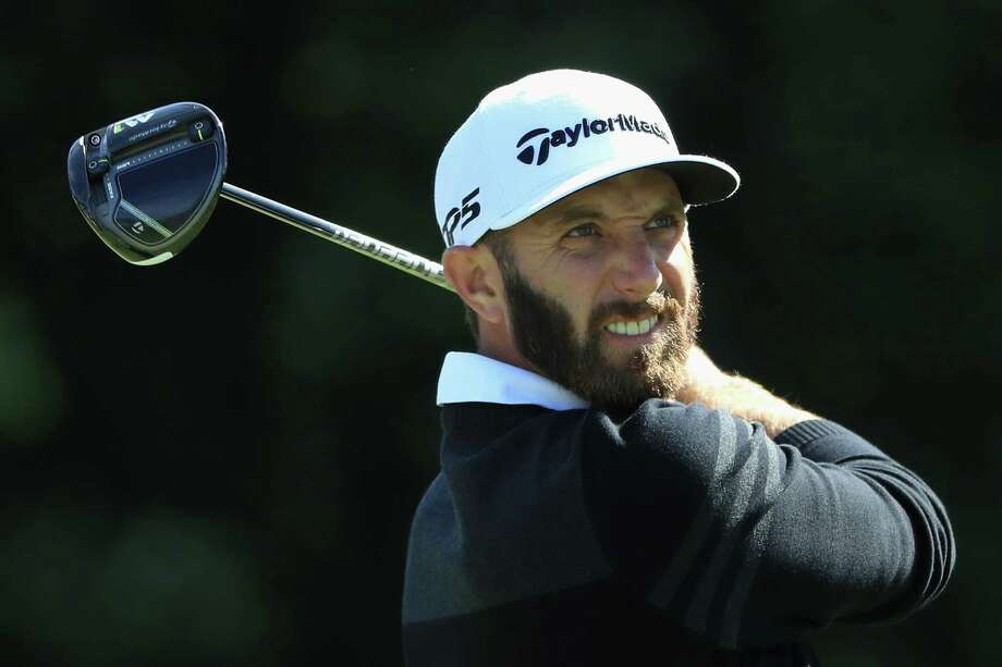 NORTON, MA - SEPTEMBER 01:  Dustin Johnson of the United States plays his shot from the 14th tee during round one of the Dell Technologies Championship at TPC Boston on September 1, 2017 in Norton, Massachusetts.  (Photo by Andrew Redington/Getty Images) Photo: Andrew Redington, Staff / 2017 Getty Images