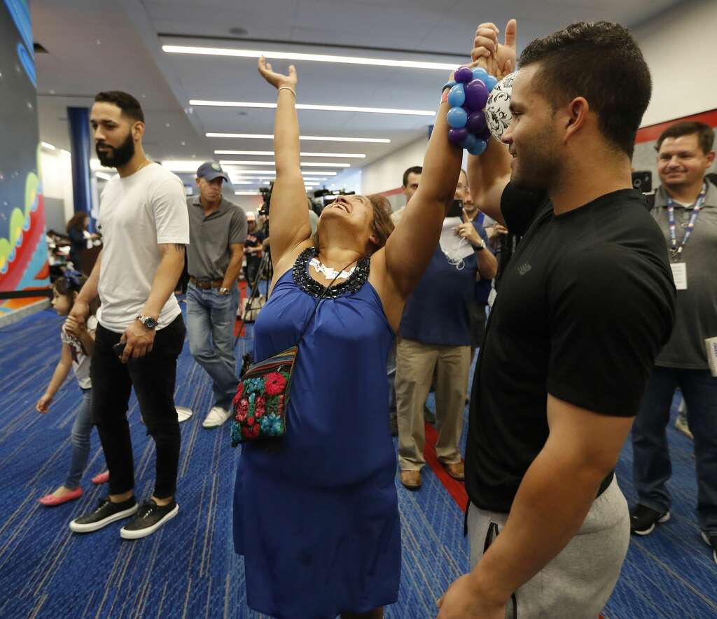 Deborah Pina reacts after dancing with Astros second baseman Jose Altuve, who visited the George