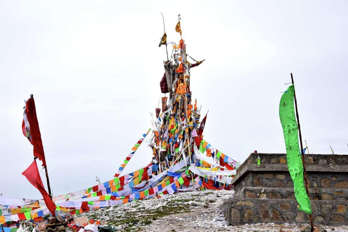 An arrangement of Tibetan prayer flags on a hill above Hezuo, capital of Gannan Tibetan Autonomous Prefecture, a region in China's Gansu province.