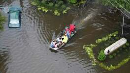 Flood victims are evacuated by boat from the Green Tree Place apartments as floodwaters rise from Tropical Storm Harvey on Tuesday, Aug. 29, 2017, in Houston. ( Brett Coomer / Houston Chronicle )