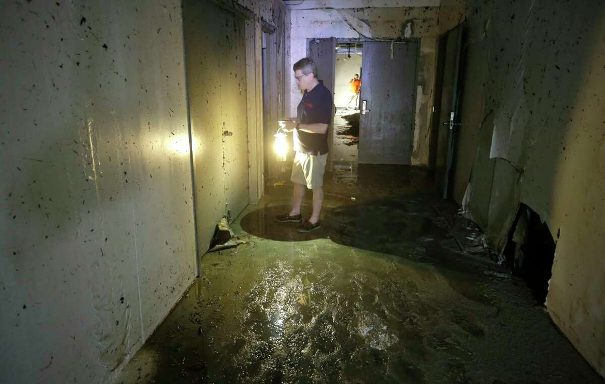 Dean Gladden, managing director, tries to open a prop room door in the flood damaged Alley Theatre, 510 Texas Ave., Friday, Sept. 1, 2017, in Houston. The Alley Theatre suffered the worst damage by far of all Houston Theater District arts organizations, with its Neuhaus theater, basement prop shop and all electronic systems destroyed due to flooding in the aftermath of Hurricane Harvey.